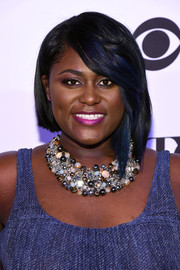Danielle Brooks looked cool wearing this blue-streaked asymmetrical bob at the Tony Honors cocktail party.