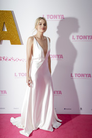 Margot Robbie looked totally alluring in a slinky white Michael Lo Sordo gown with a down-to-the-navel plunge at the Australian premiere of 'I, Tonya.'