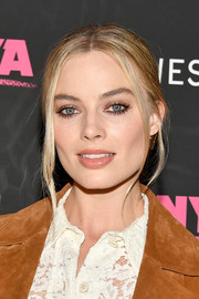 Margot Robbie opted for a simple center-parted chignon when she attended the New York premiere of 'I, Tonya.'