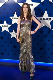 Tali Lennox struck a pose in a sequined dress at the Women of the Year Awards.