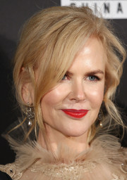 Nicole Kidman brightened up her beauty look with a swipe of red-orange lipstick.