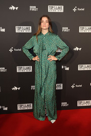 Alice Englert bundled up in a printed green maxi dress by Acne Studios for the Australian premiere of 'Top of the Lake: China Girl.'