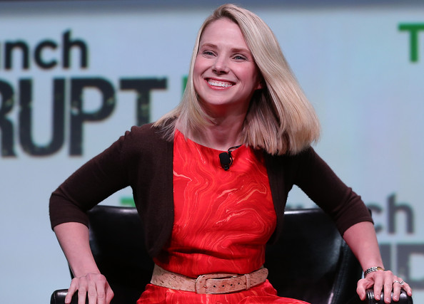 Marissa Mayer wore a cropped brown cardigan over a red dress for the TechCrunch Disrupt conference.