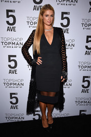 Paris Hilton went for subtle sexiness at the Topman New York City flagship opening dinner in a deep-V LBD with a sheer panel along the hemline.