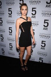 Cara Delevingne oozed sex appeal in a tight black halter mini with bondage detailing down the sides during the Topman New York City flagship opening dinner.