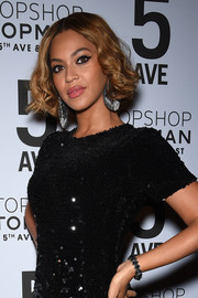 Beyonce Knowles matched her sequined dress with a black Lorraine Schwartz bracelet when she attended the Topman New York City flagship opening dinner.