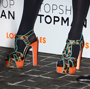 Jennifer Lopez is not one to shy away from color, especially not orange and turquoise like on the singer's platform sandals seen here.