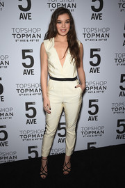 Hailee Steinfeld looked effortlessly cool at the Topman New York City flagship opening dinner in an ivory Topshop Exclusive jumpsuit featuring a plunging neckline and a black belt.