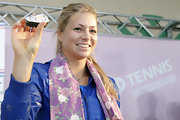 Maria Kirilenko donned a floral patterned purple scarf at the Toray Pan Pacific Open.