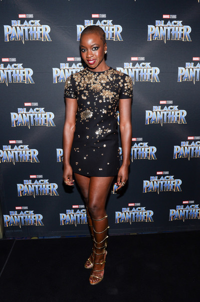 Danai Gurira contrasted her sweet frock with edgy gold gladiator heels by Giuseppe Zanotti.