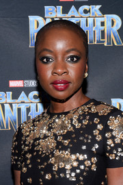 Danai Gurira attended the Toronto premiere of 'Black Panther' sporting her signature buzzcut.
