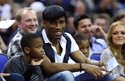 Didier Drogba looked cool in his black newsboy cap and vest while watching an NBA game.