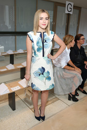 Kiernan Shipka looked simply charming in a floral dress with scalloped cap sleeves during the Tory Burch fashion show.
