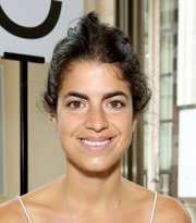 Leandra Medine pulled her hair up into a messy 'do for the Tory Burch fashion show.