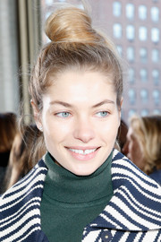 Jessica Hart sported her usual top knot when she attended the Tory Burch fashion show.
