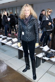 Ann Dexter-Jones completed her winter-chic look with a pair of black knee-high boots.