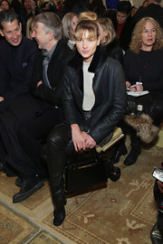 Jessica Hart kept warm in tough-chic style with this bulky black leather jacket during the Tory Burch fashion show.