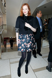 Karen Elson was vintage-chic in a fur-embellished black cropped jacket during the Tory Burch fashion show.