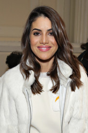 Camila Coelho wore her hair with soft waves when she attended the Tory Burch fashion show.