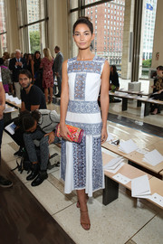 Lily Aldridge looked adorably chic at the Tory Burch fashion show in a blue and white lace-panel dress from the label.