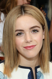 Kiernan Shipka wore her hair sleek straight with a center part during the Tory Burch fashion show.