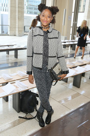 Kilo Kish sported a busy-looking geometric-patterned tweed jacket and spotted jumpsuit combo at the Tory Burch fashion show.