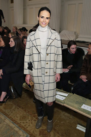 Jordana Brewster was appropriately dressed for cold weather in a Tory Burch grid-print coat and a white turtleneck during the label's fashion show.