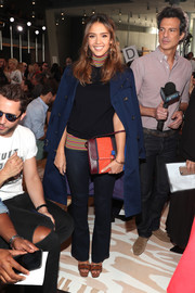 Jessica Alba paired her top with dark blue bootcut jeans.