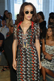 Maggie Q sported a busy-looking oversized pendant and embroidered dress combo at the Tory Burch fashion show.