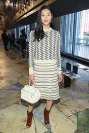 Liu Wen bundled up in a patterned crewneck sweater by Tory Burch for the label's fashion show.