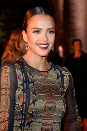Jessica Alba slicked her hair back into a tight center-parted bun for the Tory Burch Paris flagship opening.