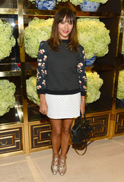 Rashida Jones completed her quirky outfit with strappy gold Tory Burch pumps.