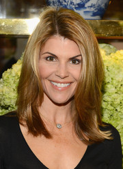 Lori Loughlin sported a chic shoulder-length layered cut at the Tory Burch Rodeo Drive opening.