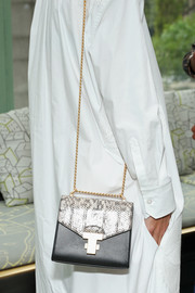 Katie Holmes attended the Tory Burch Spring 2019 show carrying a monochrome bag with a gold chain strap.
