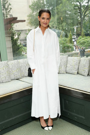 Katie Holmes covered up in a white maxi shirtdress by Tory Burch for the brand's Spring 2019 show.