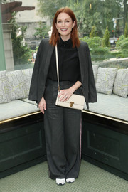 Julianne Moore looked funky in an oversized gray pantsuit by Tory Burch during the brand's Spring 2019 show.