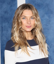 Jessica Hart rocked a messy wavy hairstyle at the Tory Sport store opening.