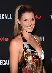 Shamone let her dress do the talking with this sleek ponytail on the red carpet.