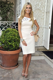Claudine Keane looked radient in this stunningly tailored cocktail dress with silver embellishment.