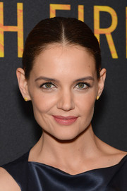 Katie Holmes paired her 'do with simple gold studs.