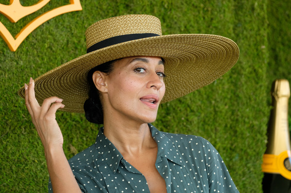 Tracee Ellis Ross Straw Hat [photo,hat,clothing,sun hat,cowboy hat,fashion accessory,headgear,grass,sombrero,fedora,arrivals,tracee ellis ross,chris delmas,will rogers state historic park,pacific palisades,veuve clicquot polo classic]
