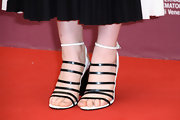 Mia stuck to minimal black-and-white from head to toe when she donned these strappy sandals.