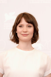 Mia's playful bob looked short and sweet with parted bangs.