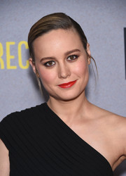 Brie Larson's red lipstick totally perked up her beauty look.