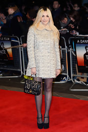 Zara Martin sported a cool retro-style tweed coat with fur trim on the neck.