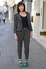 Alexandra Roach looked mod chic in this black and white checked pantsuit, which she wore to the 'Trap For Cinderella' premiere.
