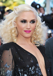 Gwen stefani amped up her glamorous look with a saturated pink lip. The fierce color called attention to her smoky lids and voluminous curls.