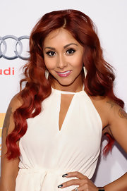 Nicole showed off her vibrant red tresses with soft waves.