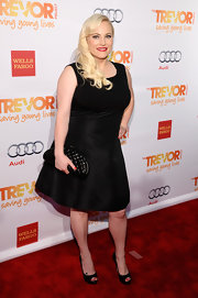 Meghan McCain kept her red carpet look simple and chic with a black A-line dress.