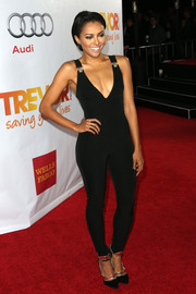 Kat Graham teamed her sexy jumpsuit with a pair of futuristic pumps.